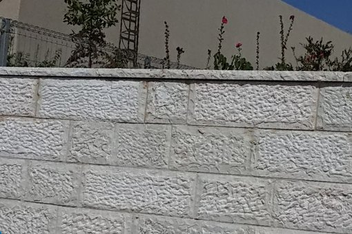 חיפוי חומה וקופינג